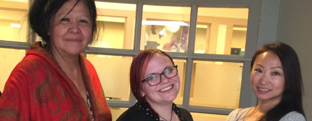 Three women at smiling at Vancouver Victims Week Meetings.